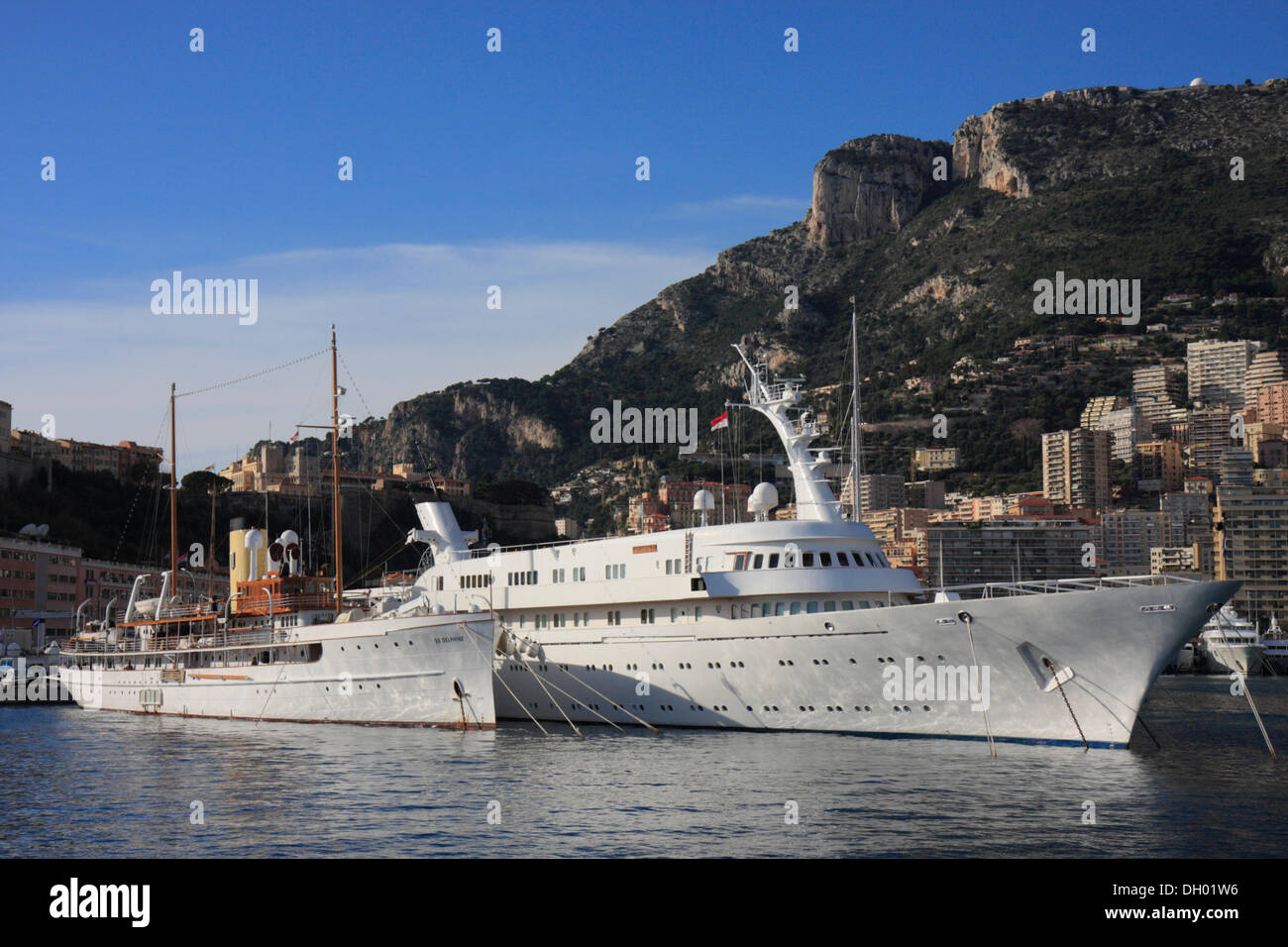 Motoryachts SS Delphine and Atlantis II in the port of La Condamine, in the back the old town with the Prince's Palace - Stock Image