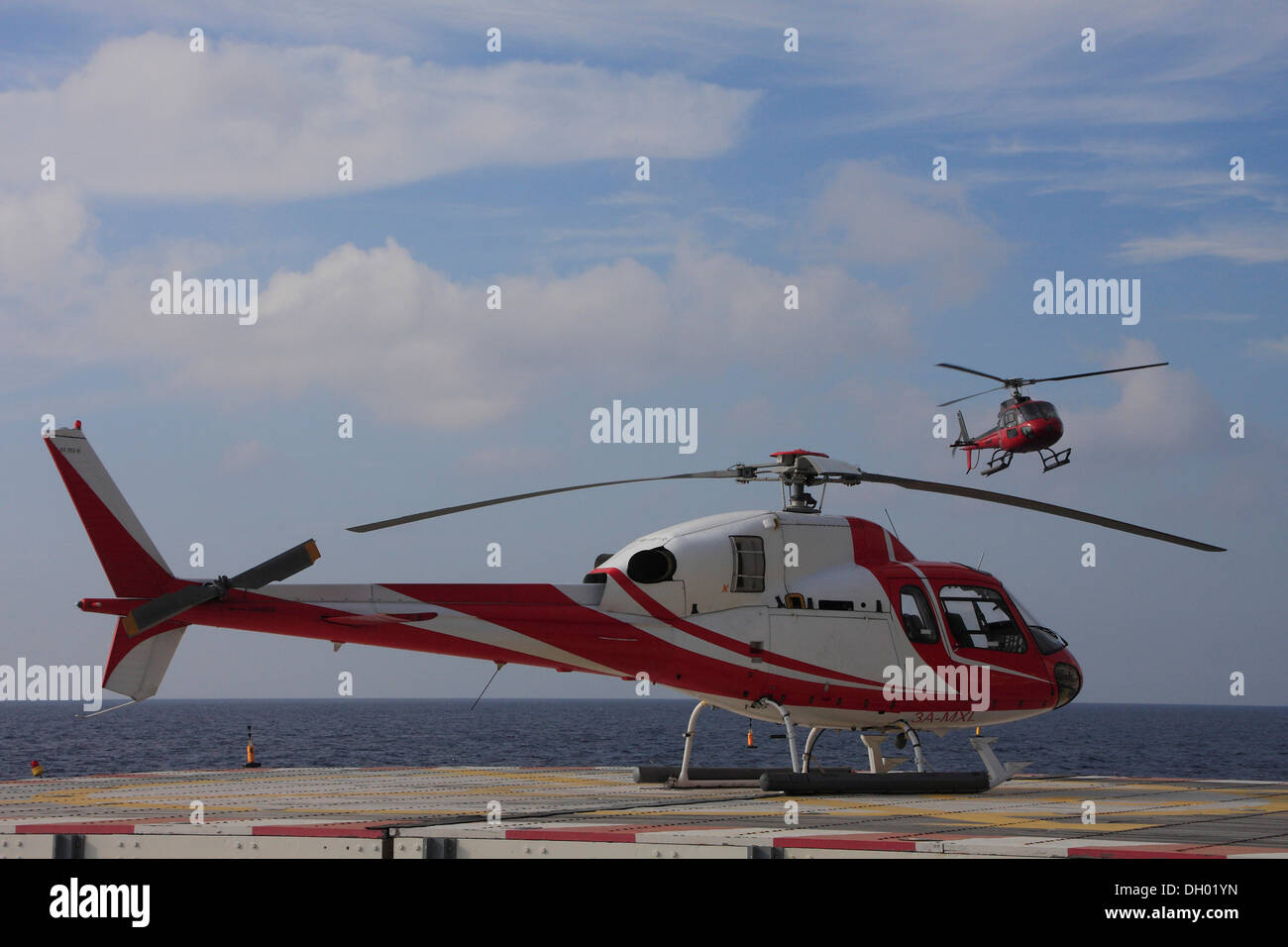Landing and parked helicopters on the Fontvieille heliport, Monaco, Cote d'Azur, Mediterranean, Europe - Stock Image