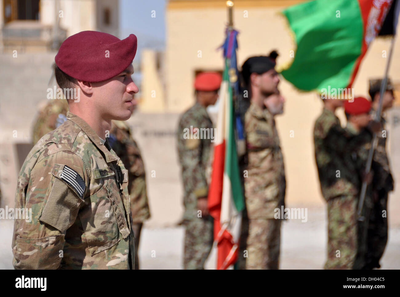 A US soldier stands at attention during a base transfer ceremony handing over Forward Operating Base Farah to the Afghan Army. - Stock Image