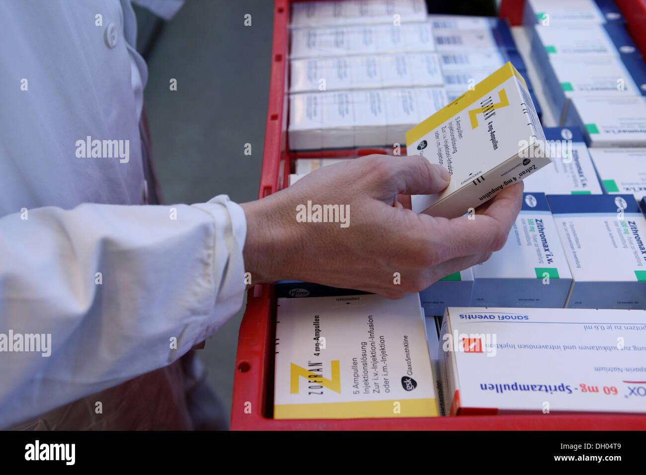 Chemist selecting medicine - Stock Image