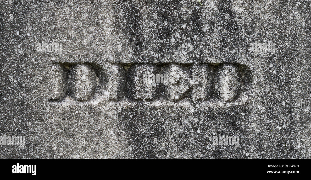 "The word ""Died"" etched on a grave stone. Stock Photo"
