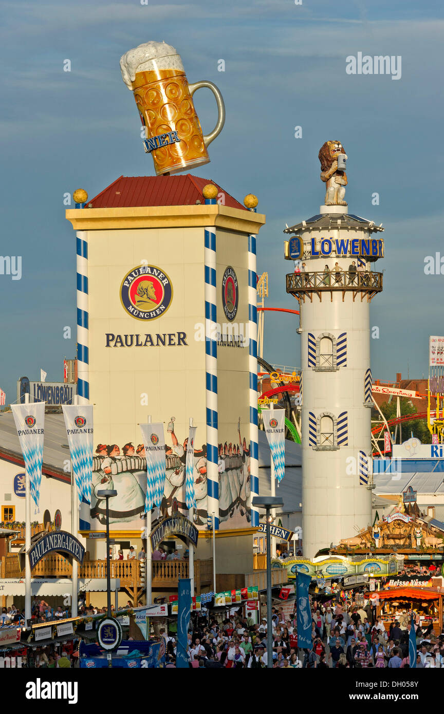 Towers of the marquees of Paulaner Breweries and Lowenbraeu at the Wies'n, Oktoberfest, Munich, Upper Bavaria, Bavaria - Stock Image