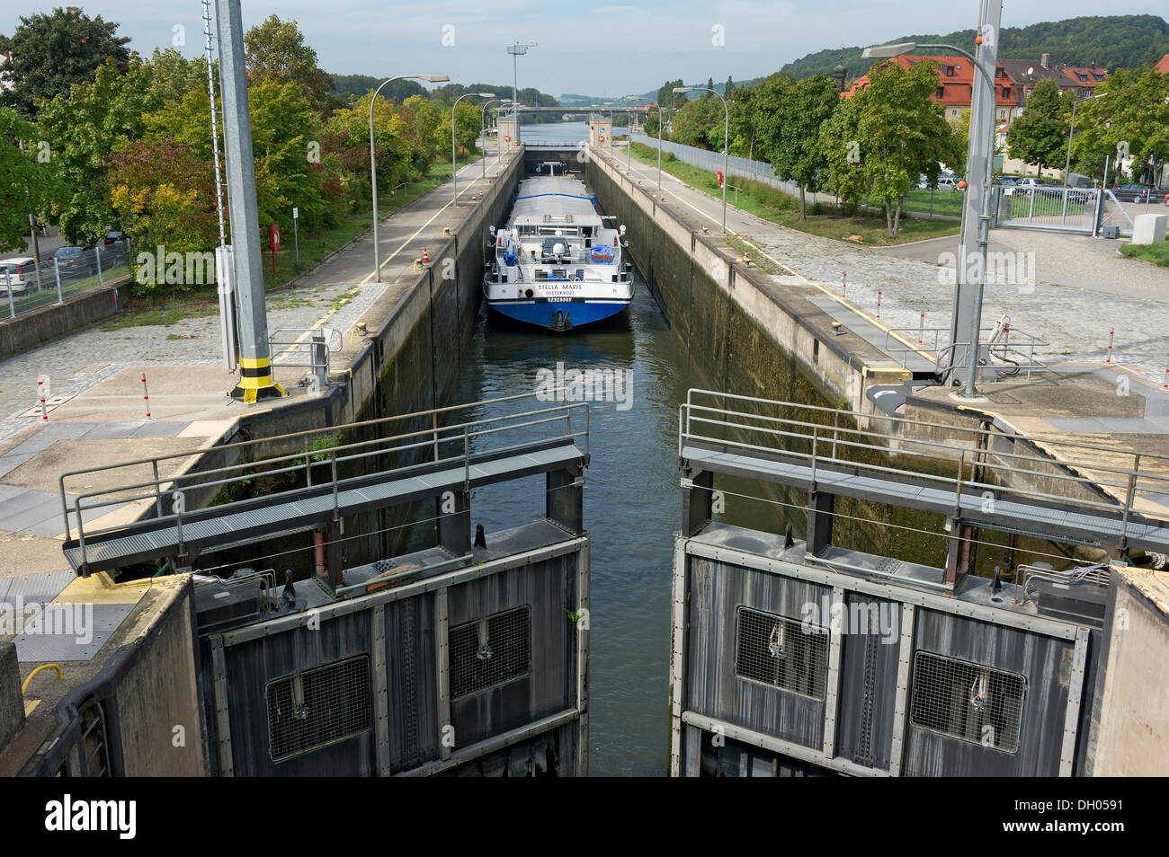 Cargo ship in a lock, sluice gates being closed for flooding, Rhine–Main–Danube Canal, Regensburg, Upper Palatinate, Bavaria - Stock Image