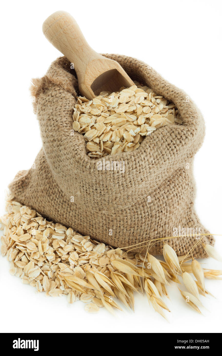 Oatmeal in small burlap sack - Stock Image