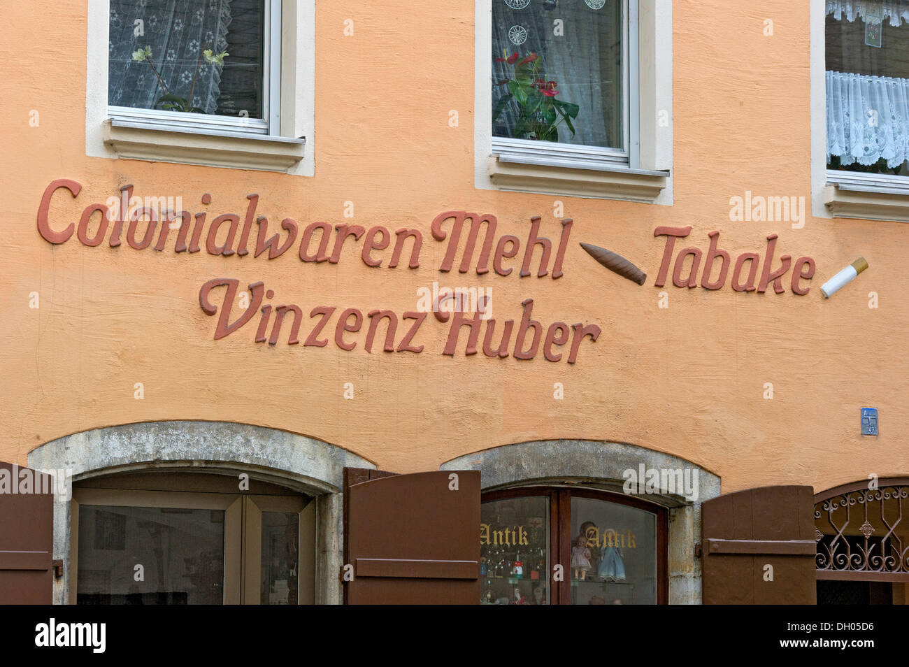 Stucco embossed lettering of a historic store, historic town centre of Regensburg, Upper Palatinate, Bavaria - Stock Image