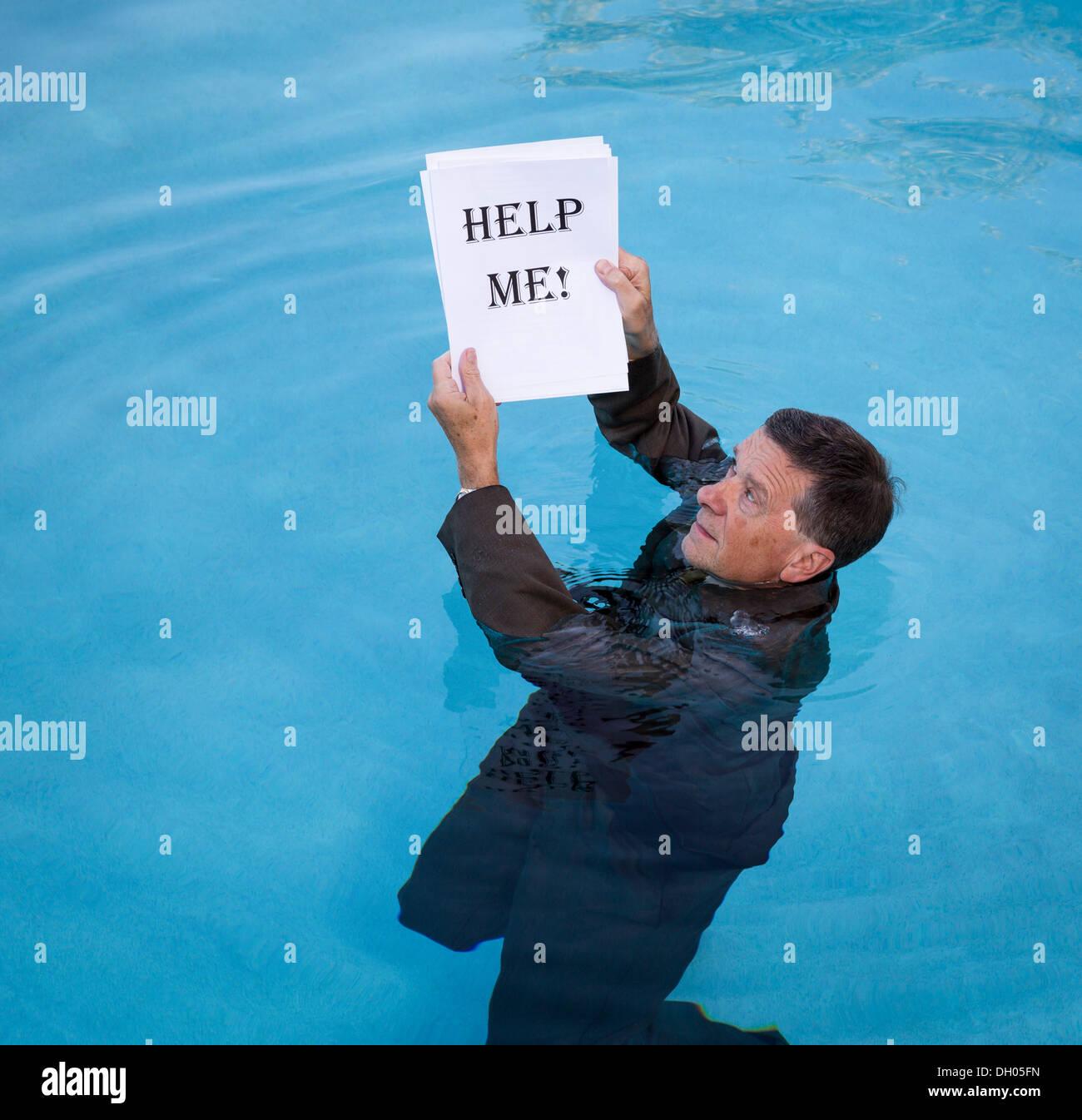 Business man in debt - help concept - Stock Image