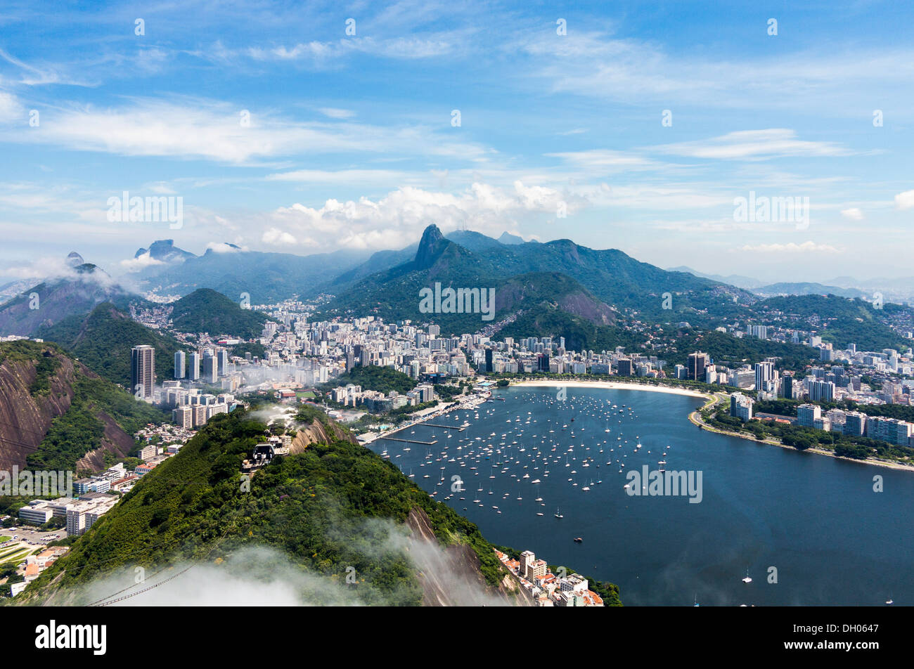 Aerial view of city and harbor of Rio de Janeiro in Brazil from cable car on Sugarloaf Mountain - Stock Image