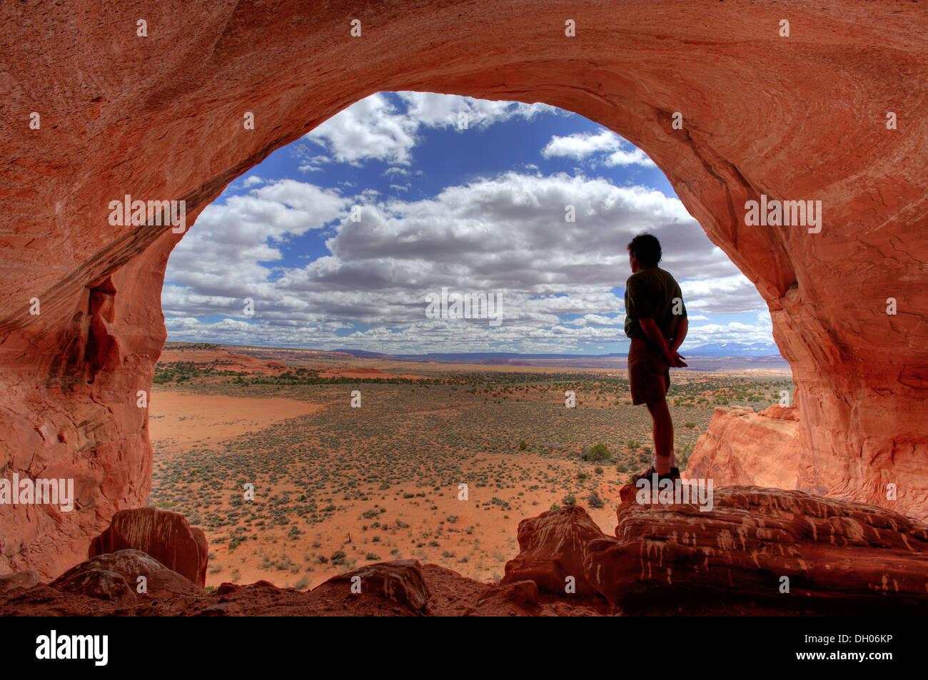 Man enjoys the view at Looking Glass Rock near Moab, Utah, USA - Stock Image