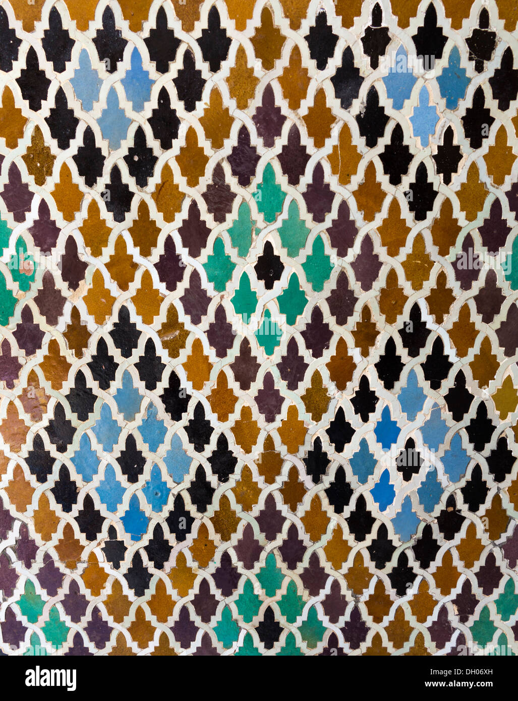 Oriental pattern mosaic of tiles in a mosque in Morocco forming diamond shapes - Stock Image