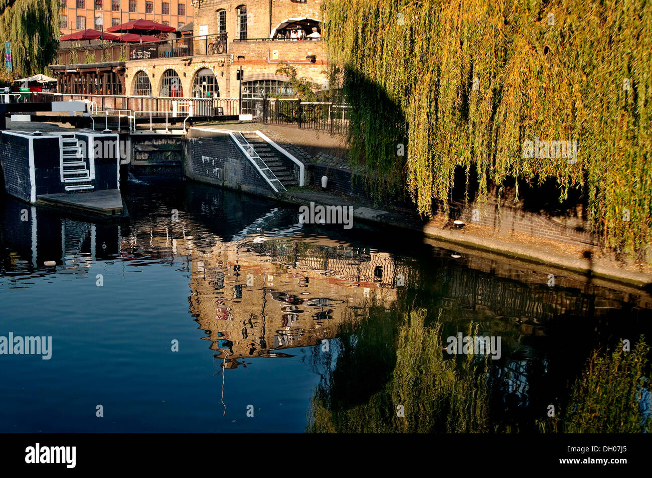Camden Lock, Regents canal lock number 1,reflections in water by tow path by Camden Market - Stock Image
