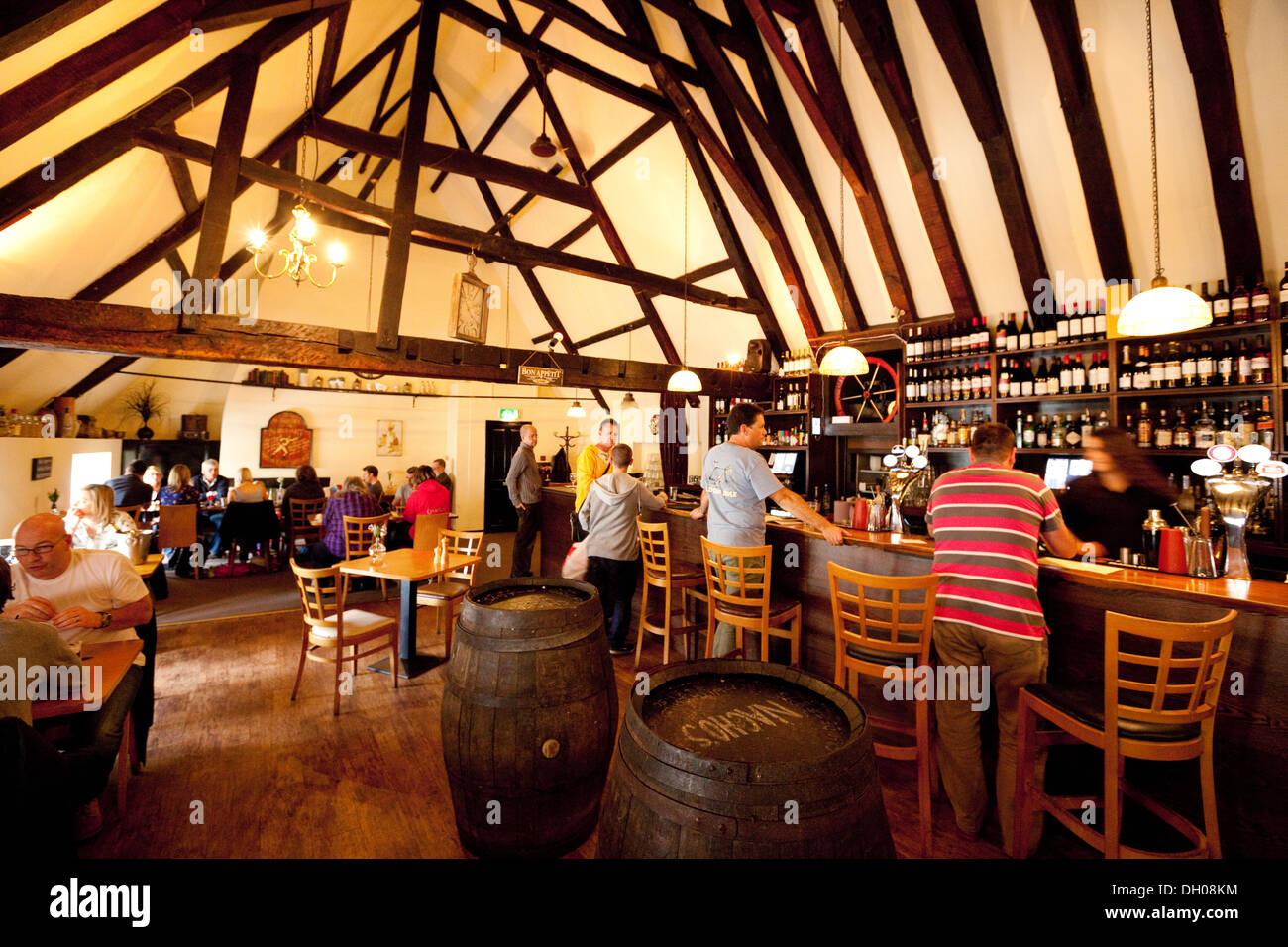 People ordering drinks and drinking, Bedfords Wine Bar and restaurant, Norwich, Norfolk UK - Stock Image
