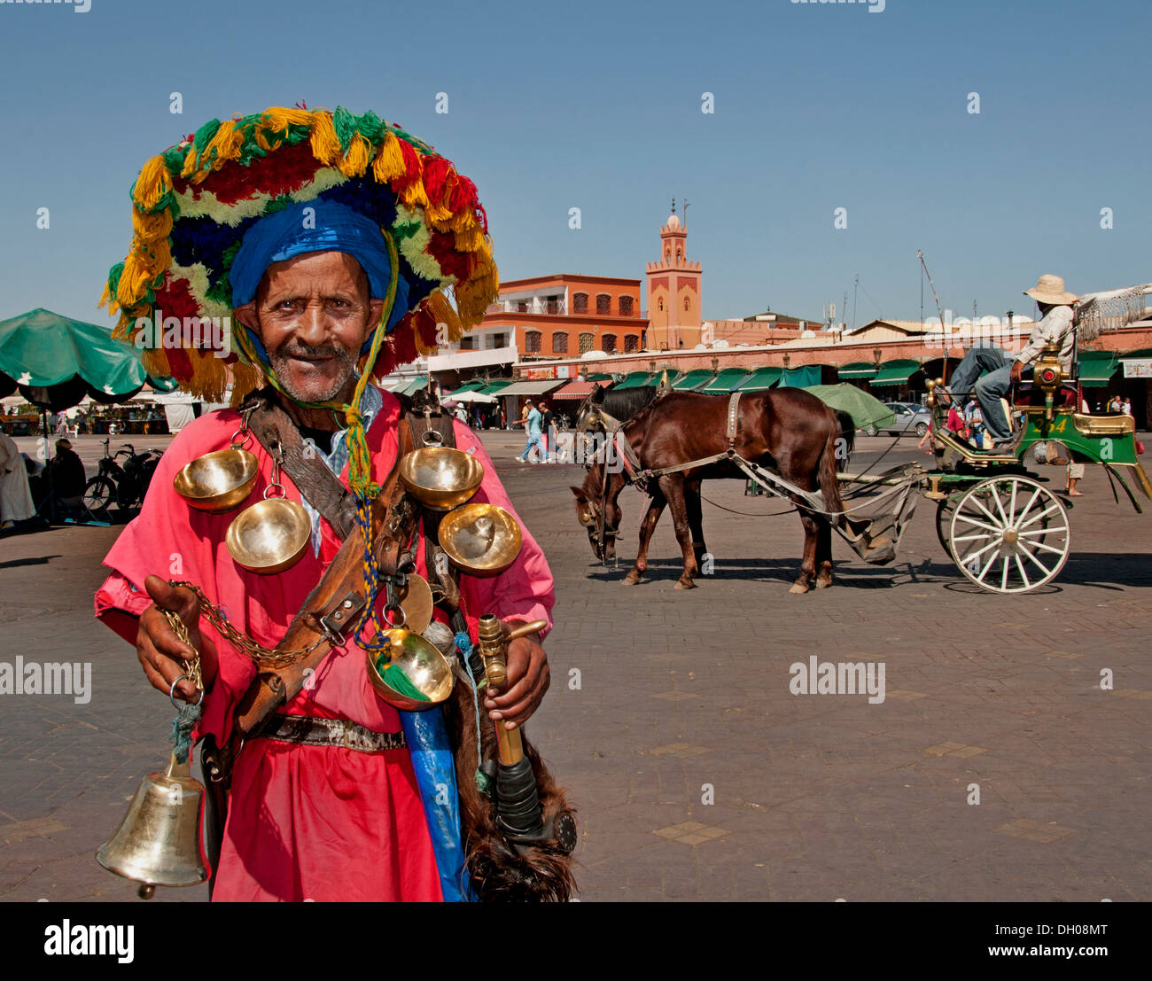 Moroccan water seller in traditional dress Jamaa el Fna square market place in Marrakesh's Medina quarter Morocco Stock Photo