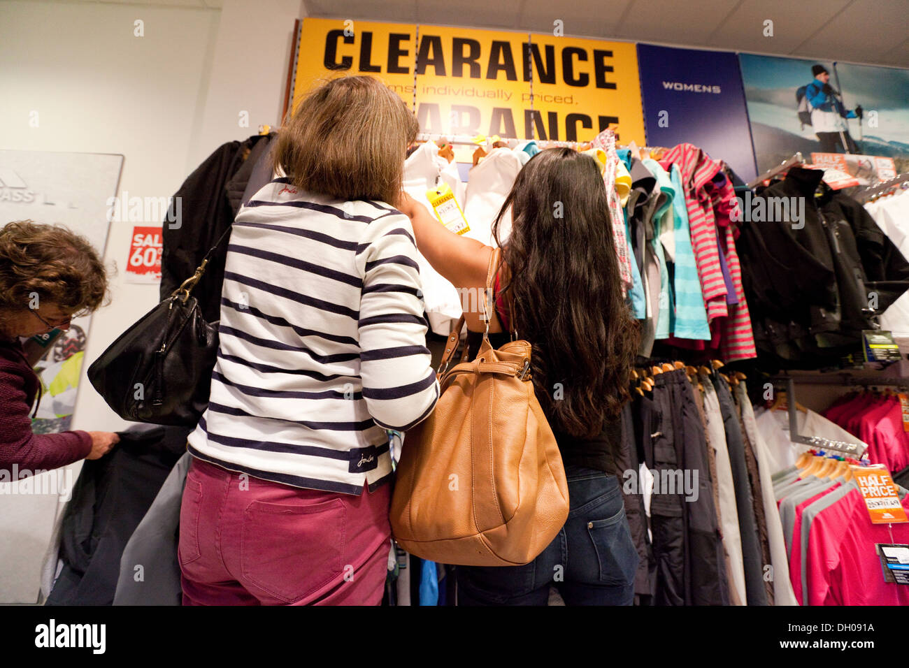 01720d13101 Women shopping for clothes in a store with a clearance sale