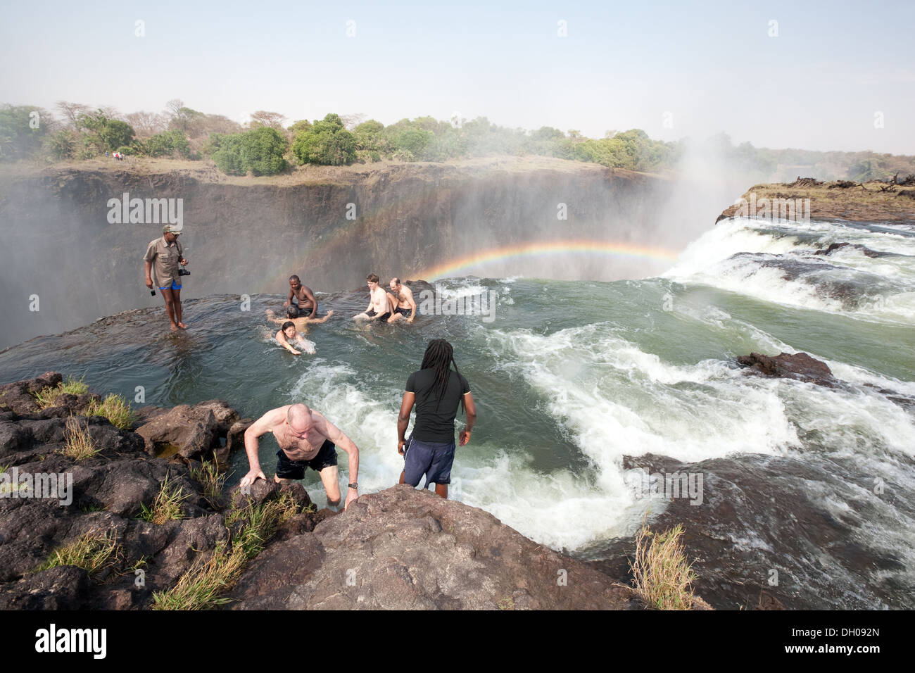 Tourists Swimming In Devils Pool On The Edge Of The Victoria Falls Stock Photo 62087389 Alamy