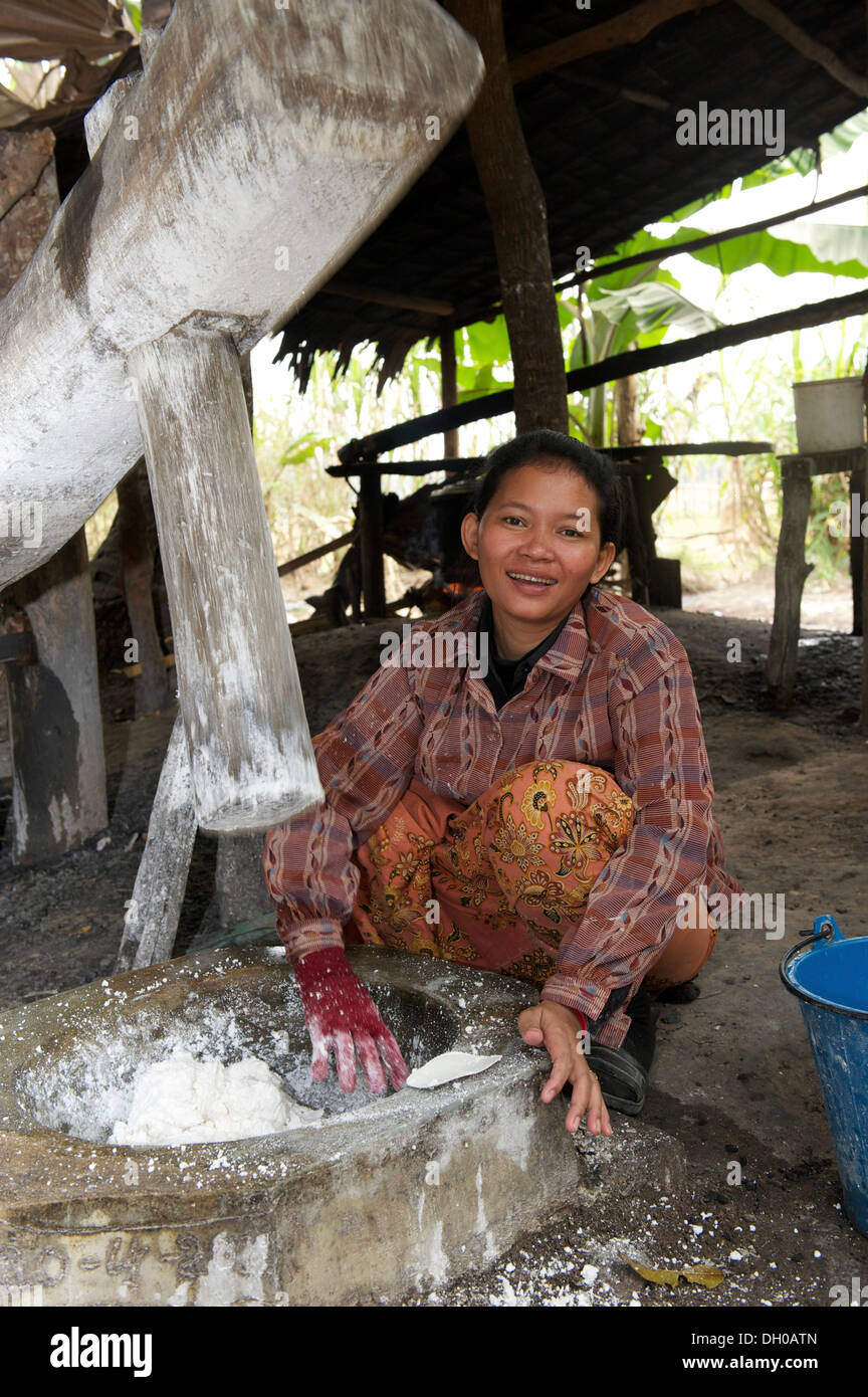 Woman kneading dough for rice noodles, Siem Reap, Siem Reap, Siem Reap Province, Cambodia - Stock Image