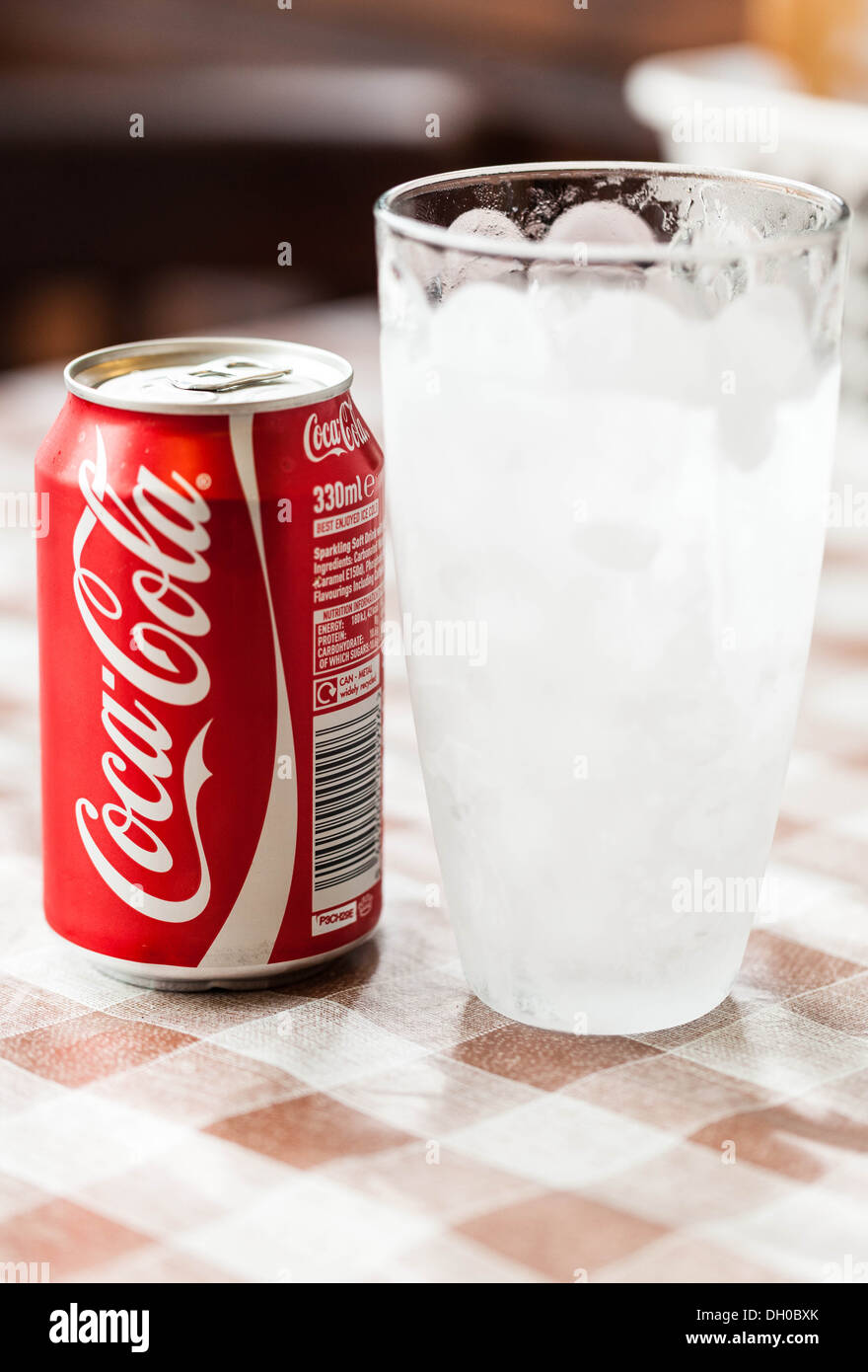 Coca Cola can and glass - Stock Image