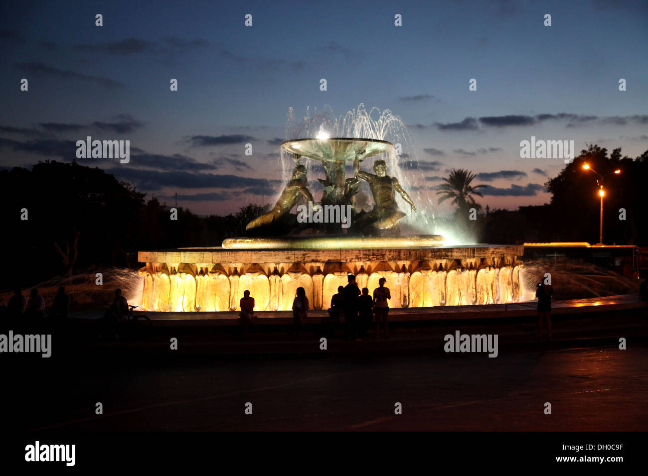 The fountain is a mecca for locals in the evening when they congregate around its base - Stock Image