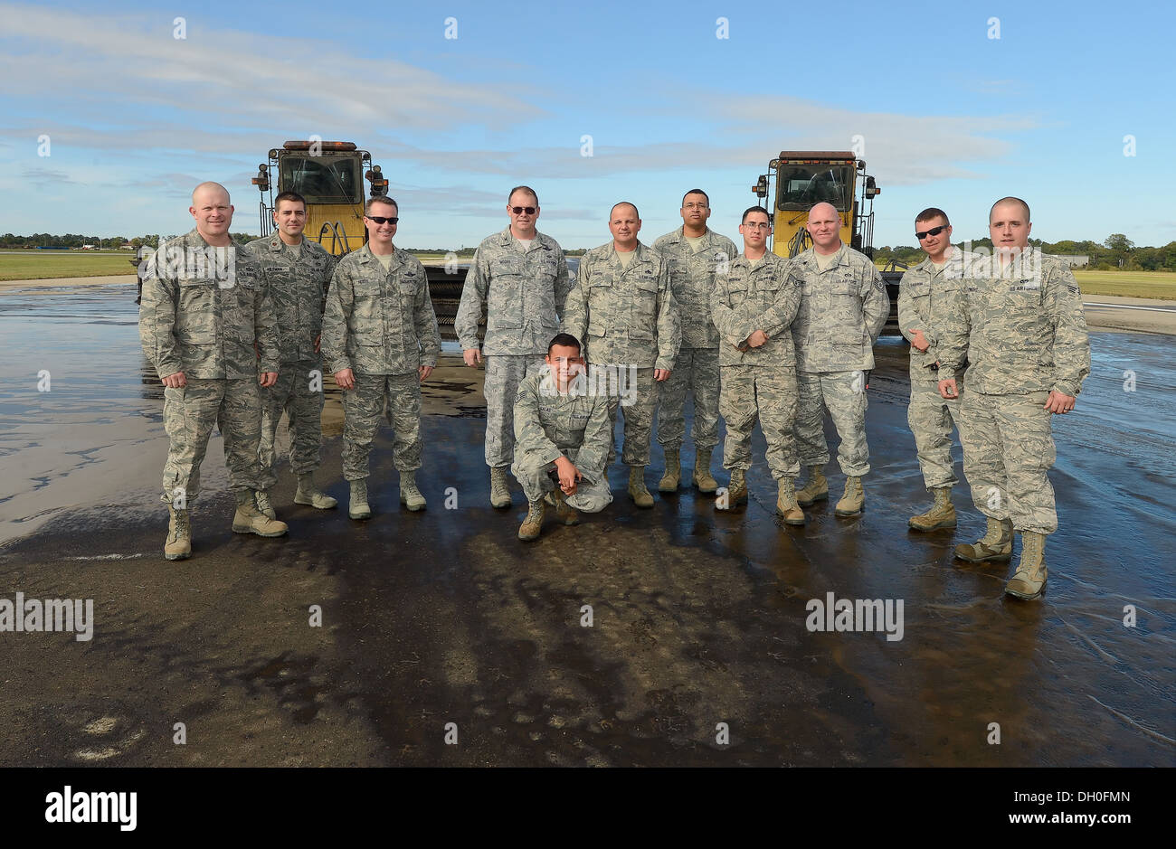 Senior leaders of the 436th Airlift Wing join with 436th Civil Engineer Squadron, pavement and heavy equipment operators section, to better understand how the CE team accomplishes the task of rubber removel at Dover Air Force Base, Del. on Oct. 15, 2013. - Stock Image