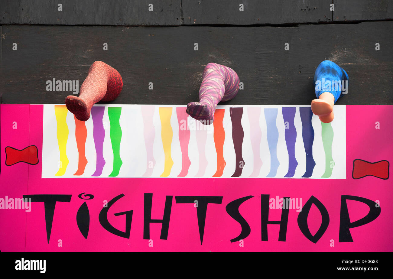 womens tight shop colorful mannequin legs over sign - Stock Image