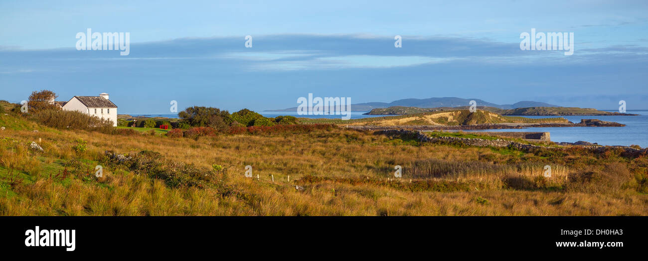County Galway, Ireland: Morning sun on the headlands of Rinvyle Point in the Connemara Region with Inishbofin Island - Stock Image
