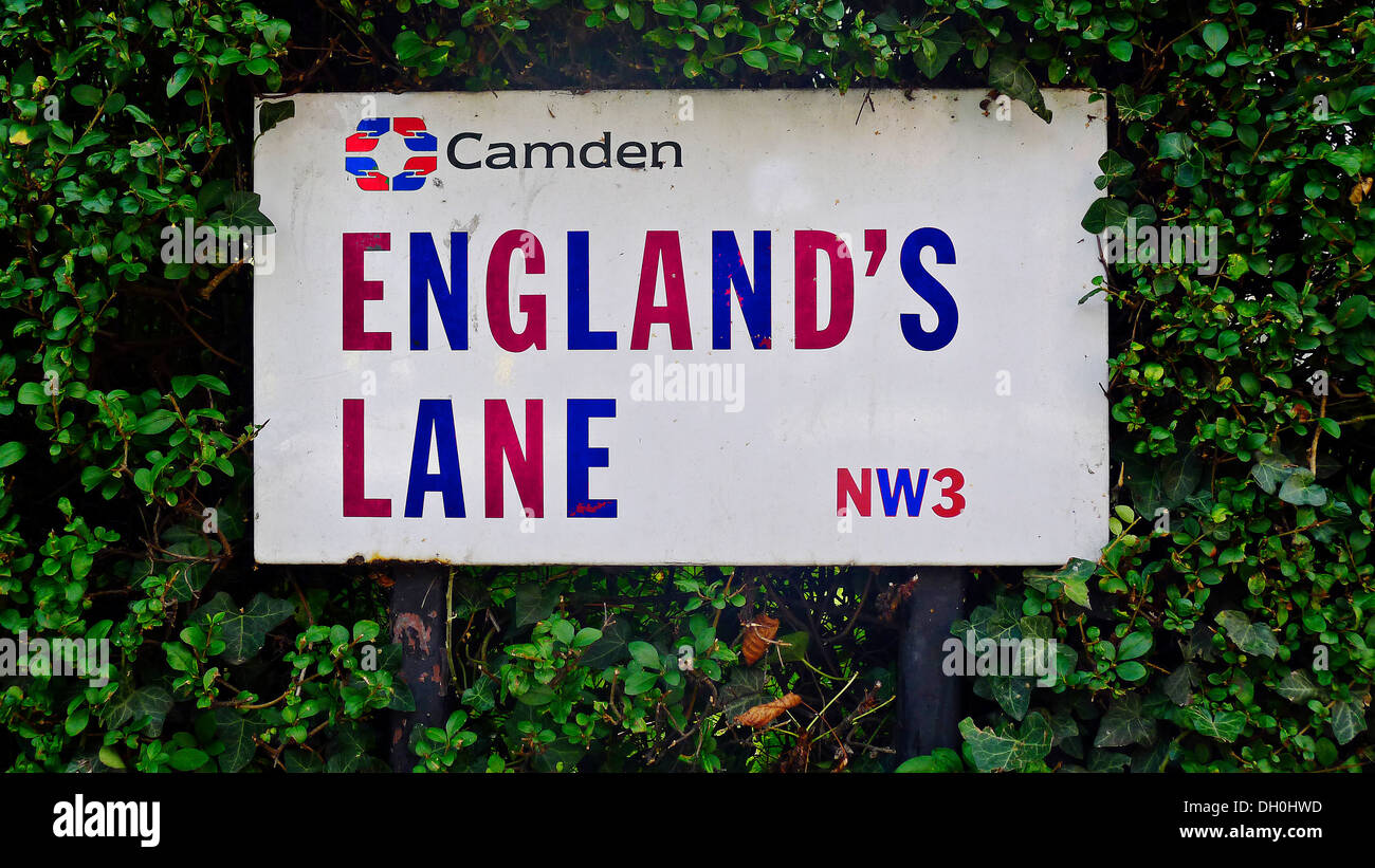 England's lane NW3 street sign in Red White and Blue Borough of Camden Logo  Green hedge - Stock Image
