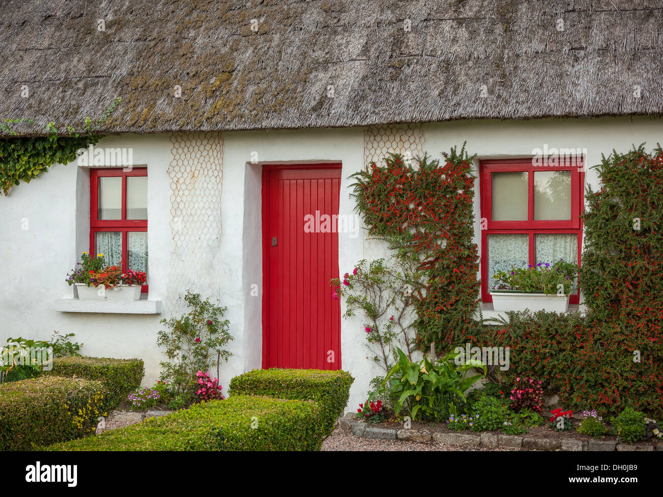 County Galway Ireland Thatched roof cottage with red doors and windows. & County Galway Ireland: Thatched roof cottage with red doors and ...
