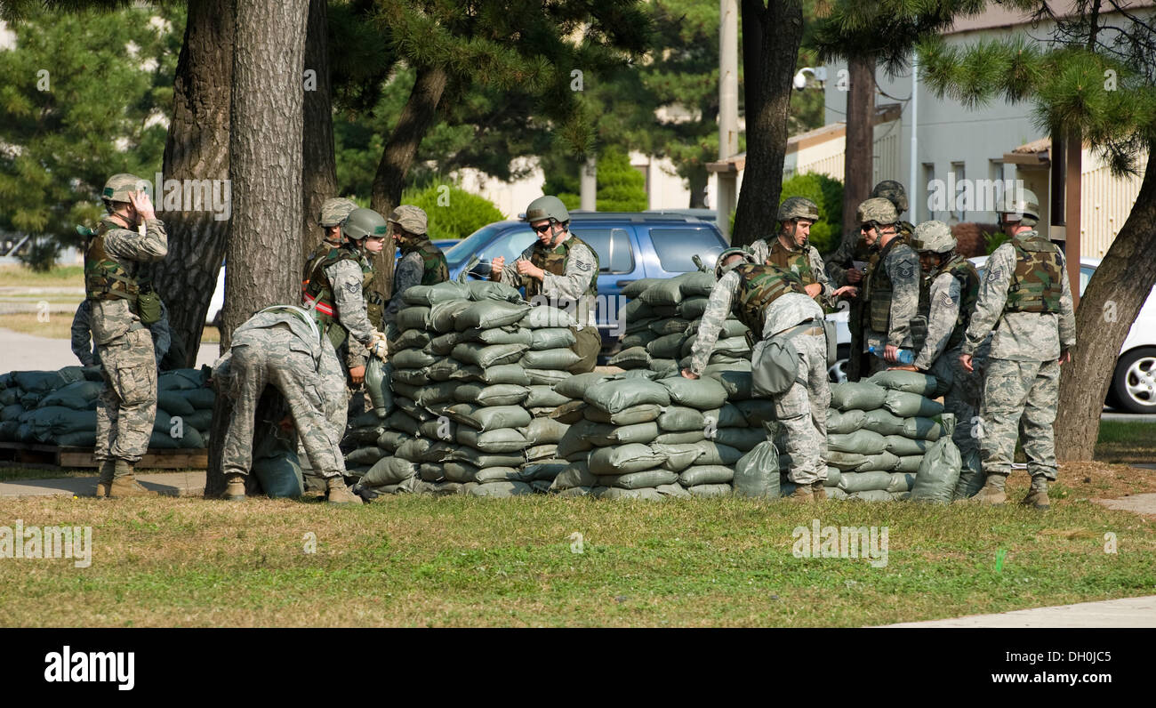 The 8th Civil Engineer Squadron Red Devils construct a defensive fighting position during a training exercise at Kunsan Air Base, Republic of Korea, Oct. 24, 2013. Airmen from the 8th CES trained with the 8th Security Forces Squadron on how to defend thei - Stock Image
