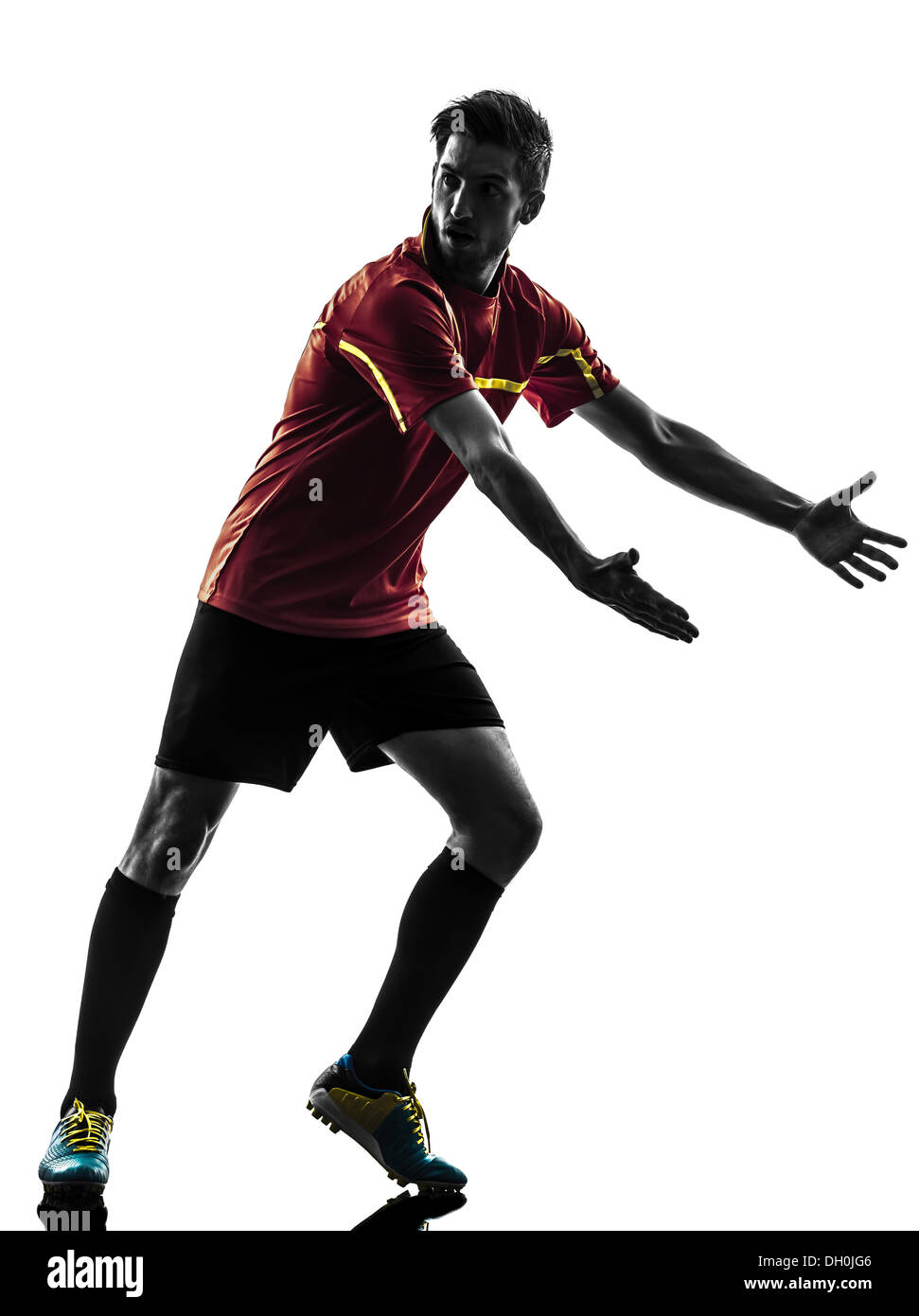 one man soccer player complaining playing football competition in silhouette on white background - Stock Image