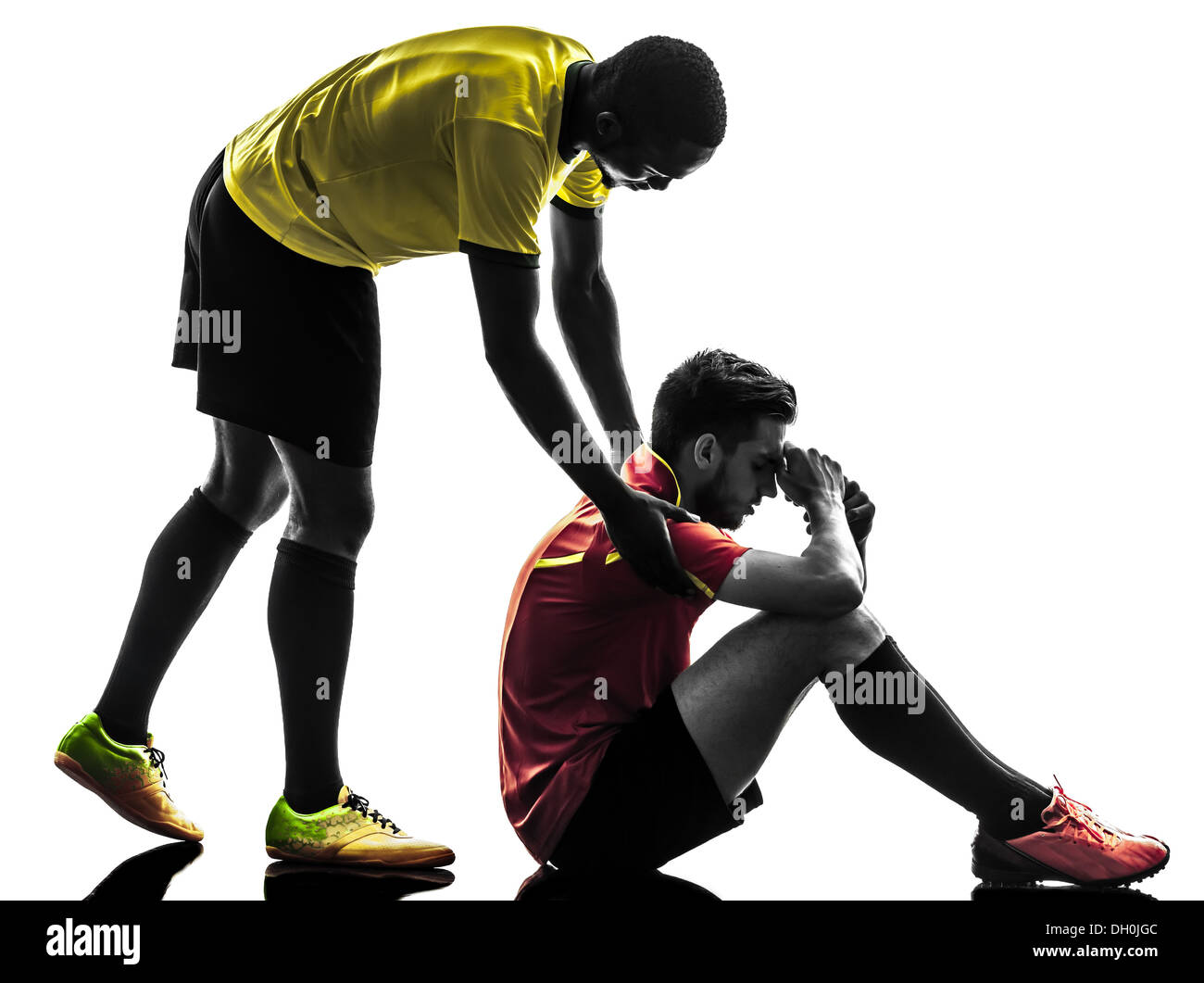 two men soccer player playing football competition fair play concept in silhouette on white background - Stock Image