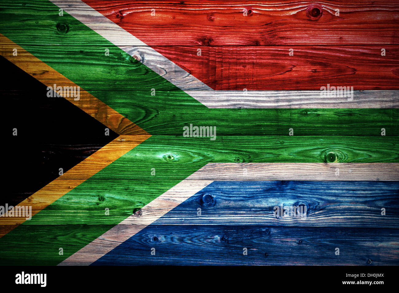 Republic of South Africa flag on a weathered natural wooden surface close-up - Stock Image