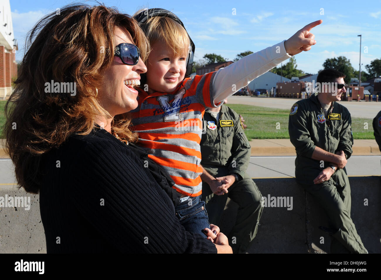 Sue Reynolds and her grandson, Gavin Heath, await the arrival of Gavin's father, Capt. Kevin Heath, 27th Fighter Squadron assistant director of operations, at Langley Air Force Base, Va., Oct. 21, 2013. While deployed, the 27th FS helped to support Theate - Stock Image