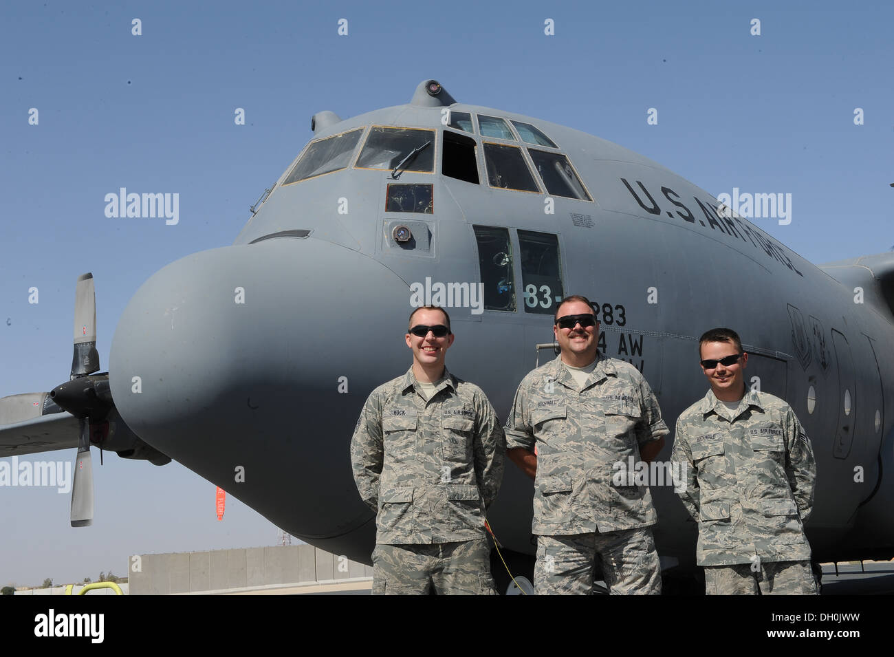 Senior Master Sgt. Steven Buchwald is flanked by his son-in-law Senior Airman Hans Hock on his right and his son, Senior Airman - Stock Image