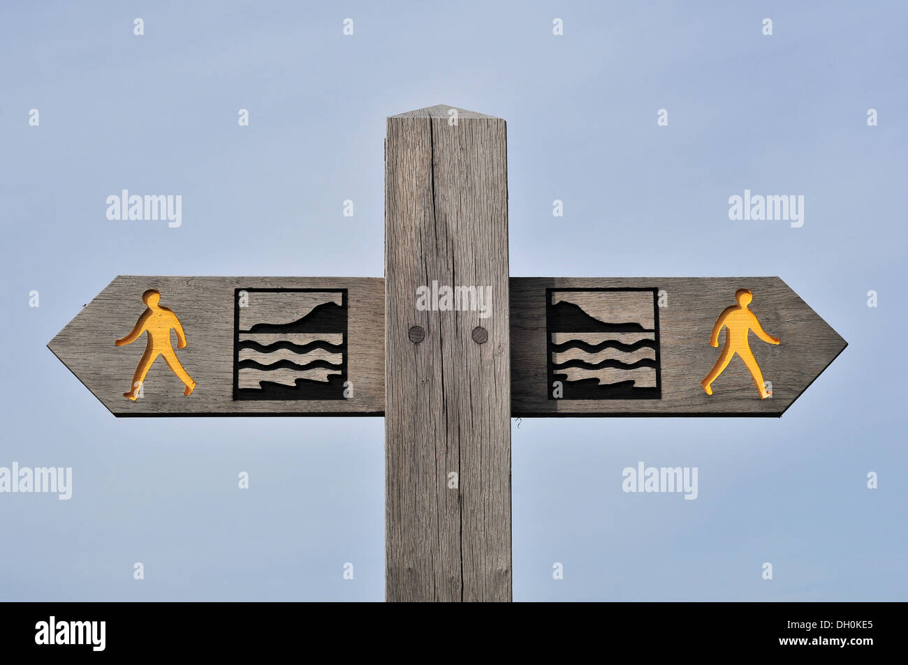 Wooden finger signpost showing the route of the Wales Coast Path near Aberystwyth, Ceredigion, Wales, UK - Stock Image