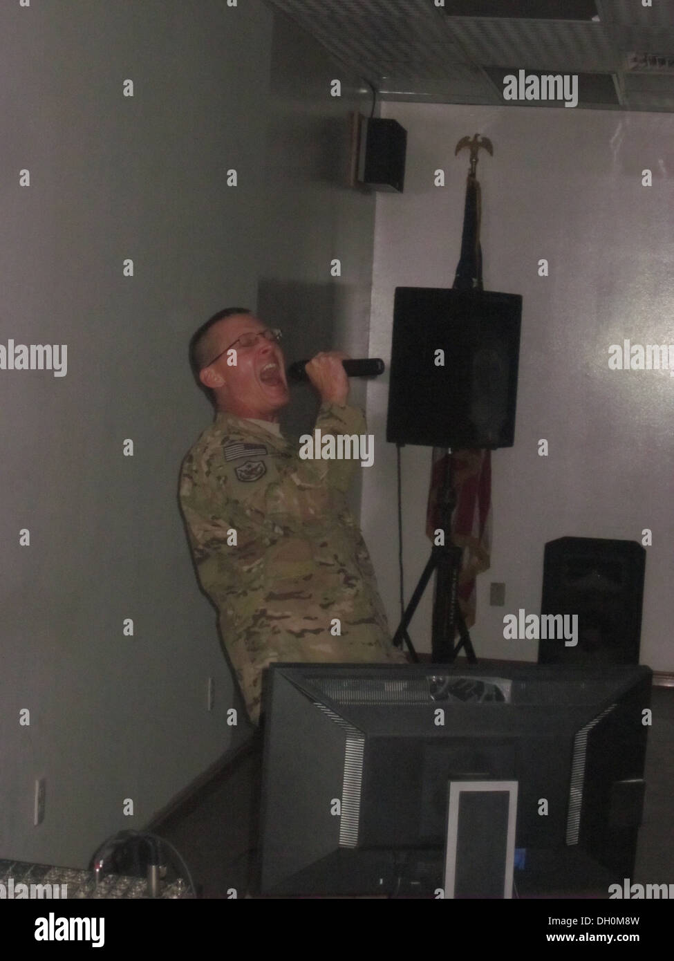 More than 30 people attended the weekly Karaoke singing event Oct. 25, 2013 at the Vulture's Nest recreation center on Bagram Air Field, Afghanistan. - Stock Image
