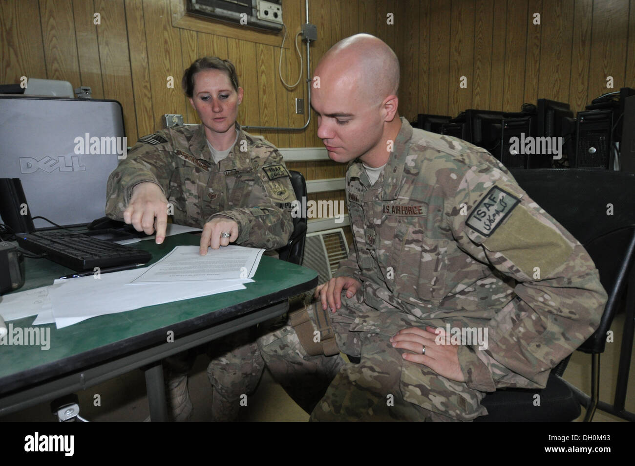 Staff Sgt. Megan Stockinger, 455th Air Expeditionary Wing NCO in charge of military justice, deployed from Little Rock Air Force Base, Ark., and a native of Geneva, Ala., provides legal assistance to Staff Sgt. Lowell Wann, 455 AEW chaplain assistant, dep Stock Photo