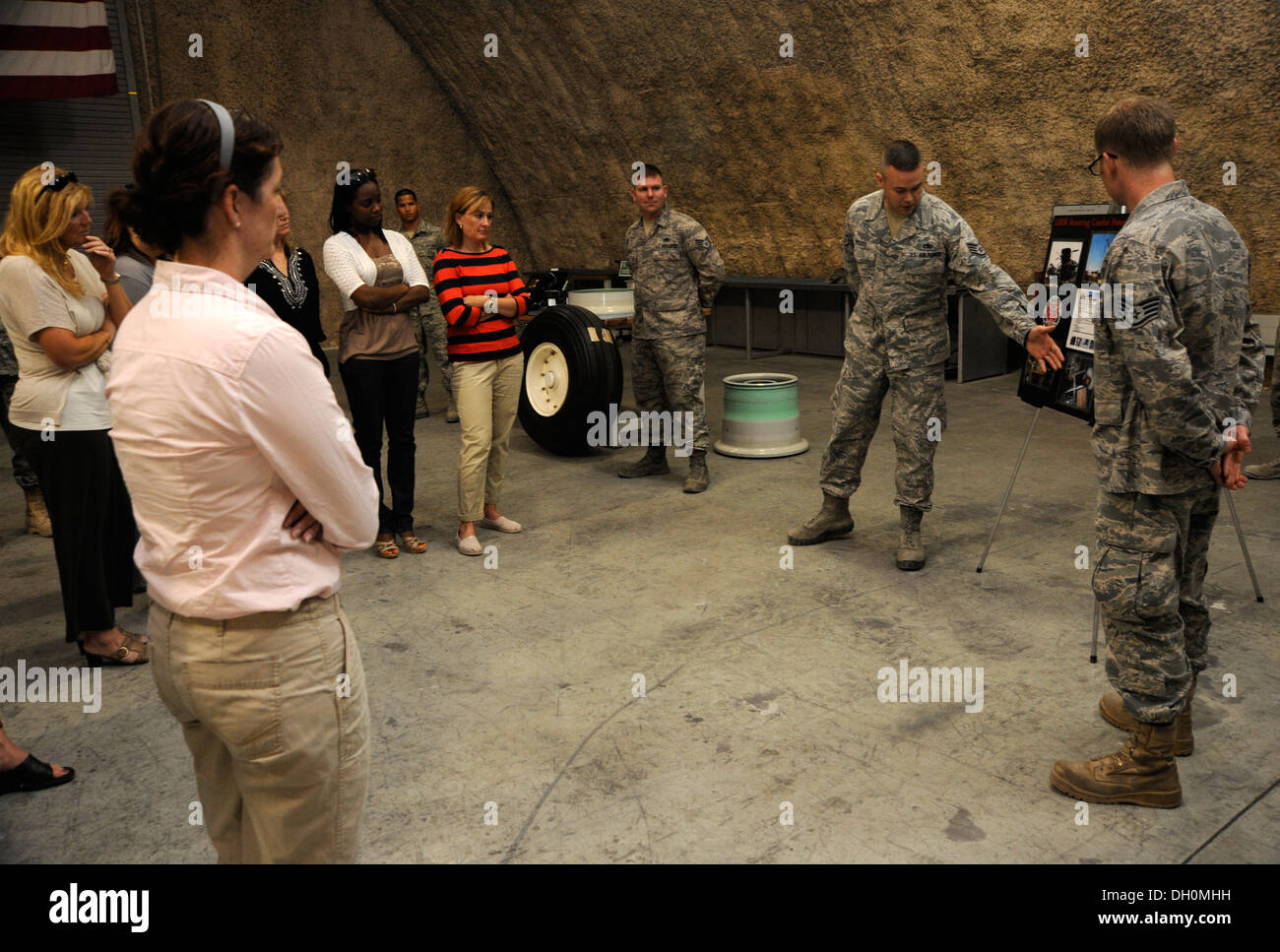 Military spouses receive a mission brief on airfield battle damage recovery during a Command Sponsorship Program tour at the 379th Air Expeditionary Wing in Southwest Asia, Oct. 23, 2013. The CSP is an accompanied-tour initiative started in 2011 to increa - Stock Image