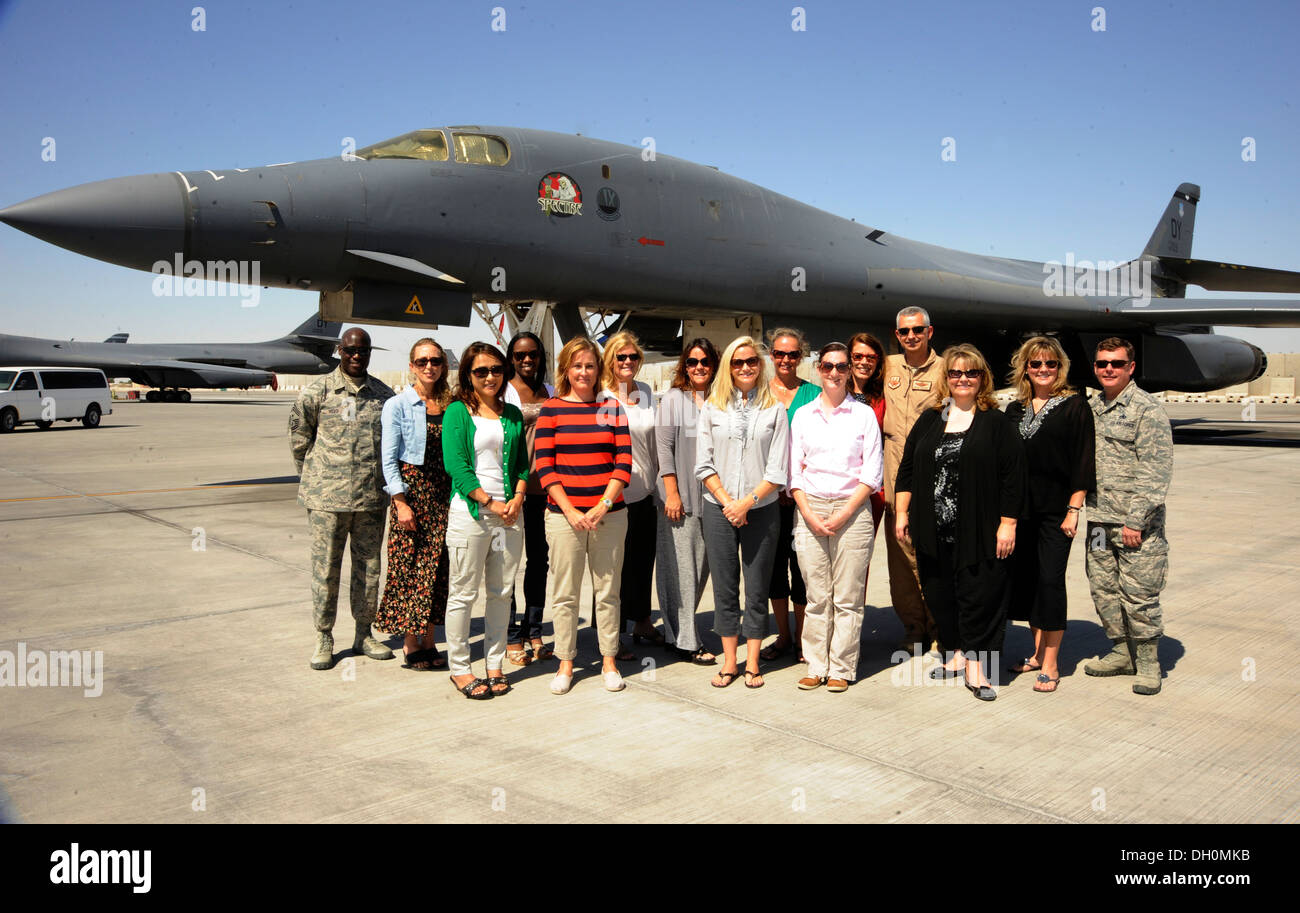 Military spouses pose with 379th Air Expeditionary Wing leaders during a Command Sponsorship Program tour at the 379th AEW in Southwest Asia, Oct. 23, 2013. The CSP is an accompanied-tour initiative started in 2011 to increase mission effectiveness throug - Stock Image