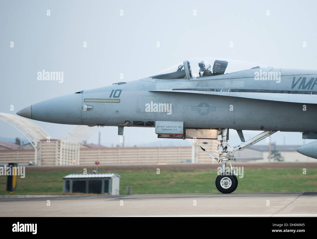 A U.S. Marine F-18 Hornet, from Iwakuni Marine Corps Air Station, Japan, takes off during Max Thunder 13-2 at Kunsan Air Base, Republic of Korea, Oct. 28, 2013. U.S. Air Force Airmen, U.S. Air Force Airmen, U.S. Marines and Republic of Korea air forces ki - Stock Image