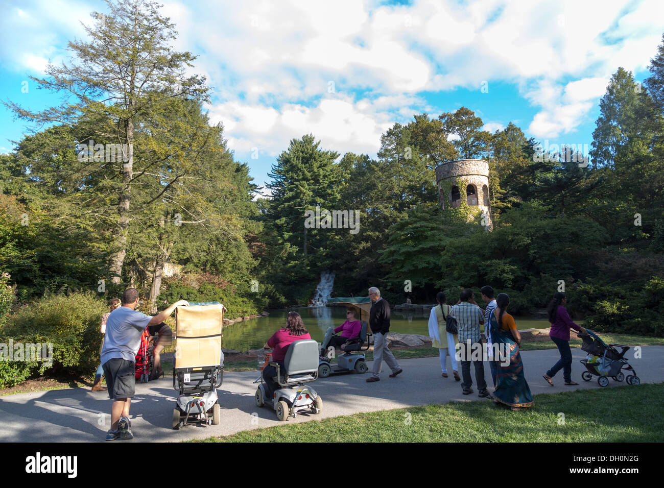 disabled persons in electric wheelchairs at Longwood Gardens, Kennett Square, Pennsylvania, USA - Stock Image