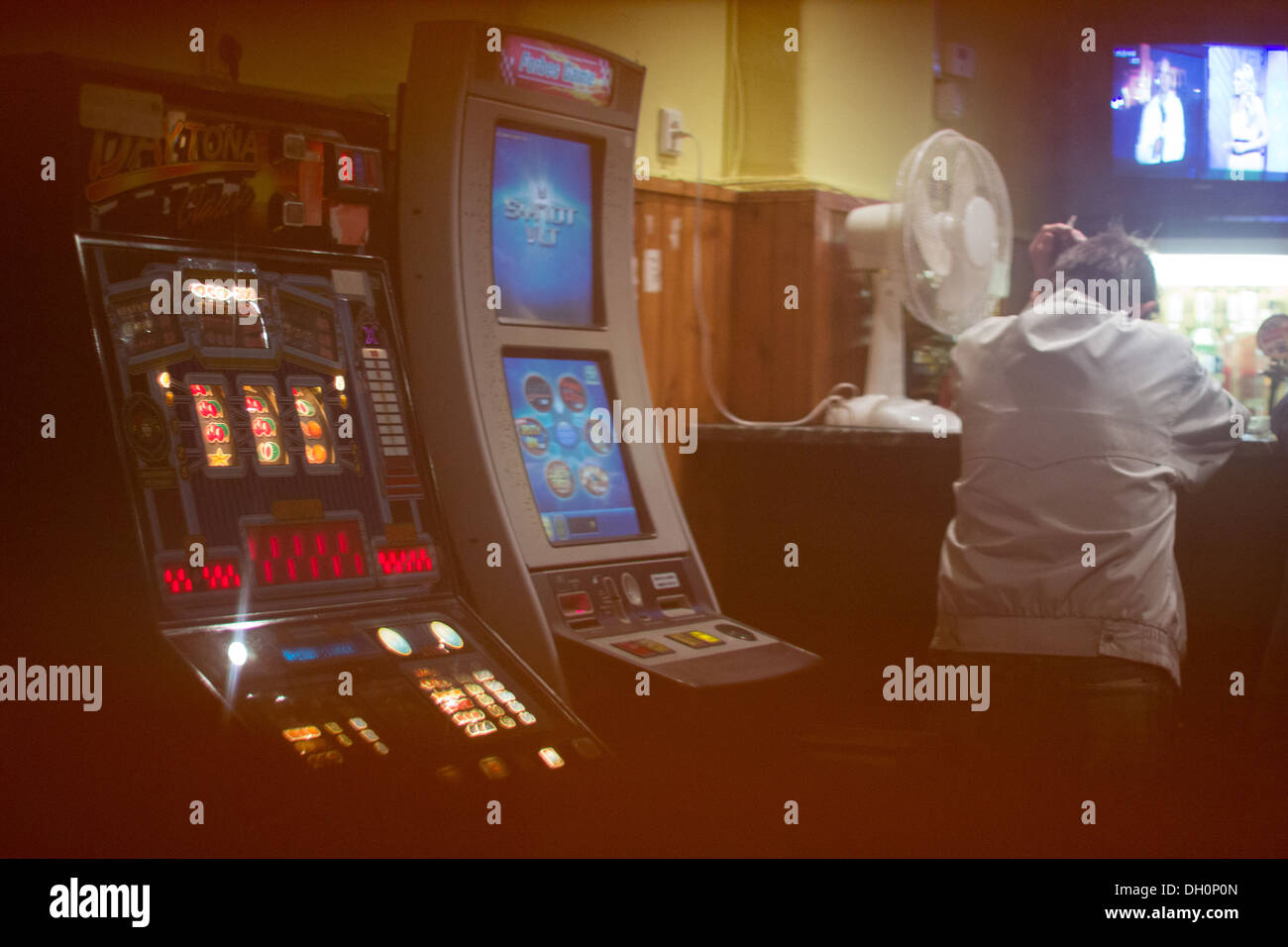 A gambler in Casino, Czech republic, country with the highest density of gambling machines - Stock Image