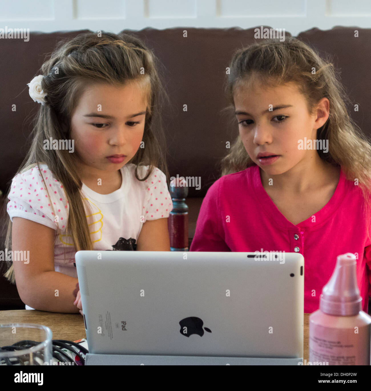 girls watching a film on an Apple iPad - Stock Image
