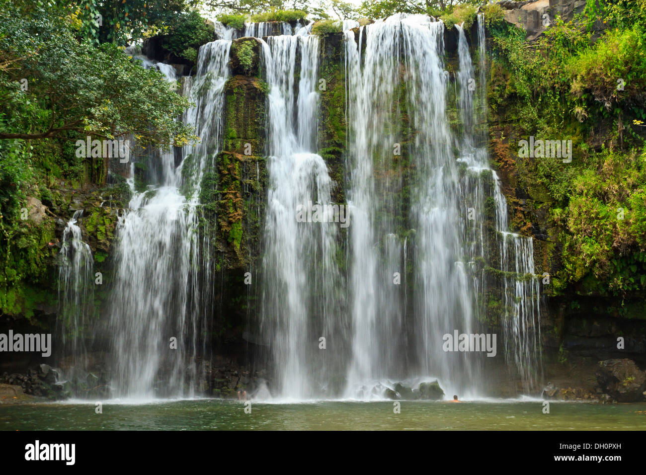 Idyllic Llano de Cortes waterfall in the jungle near Bagaces, Costa Rica - Stock Image