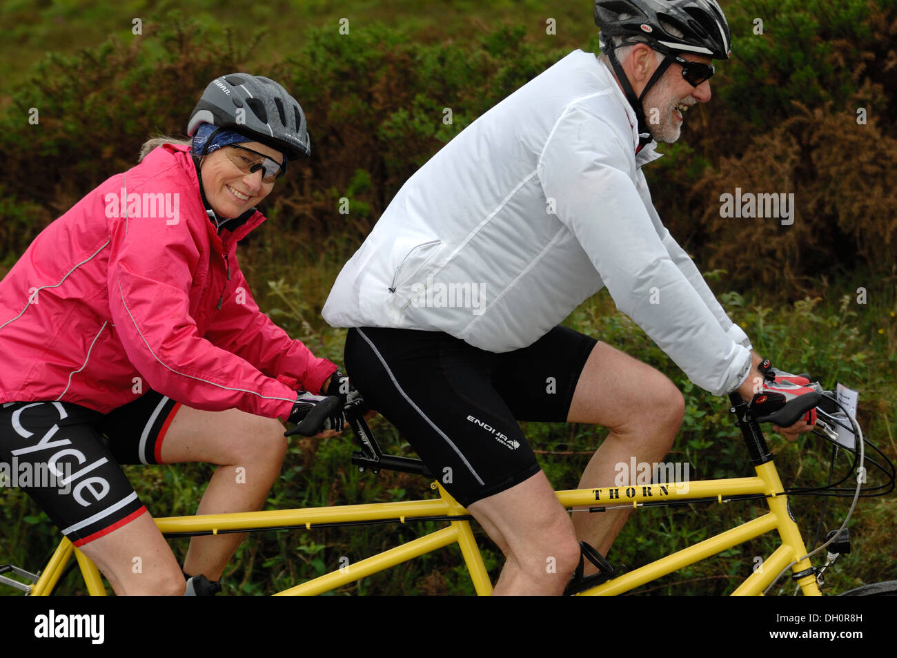 A man and woman on a tandem riding the Dartmoor classic cyclosportive 2013 - Stock Image