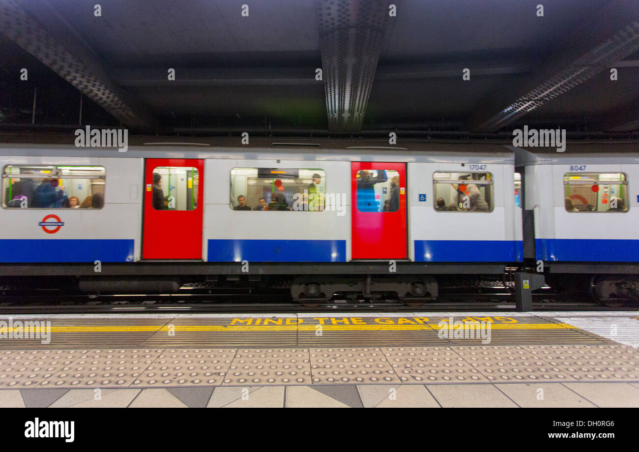 26/10/2013 Mind The Gap. warning sign and London tube train in a station, London, England, UK Stock Photo