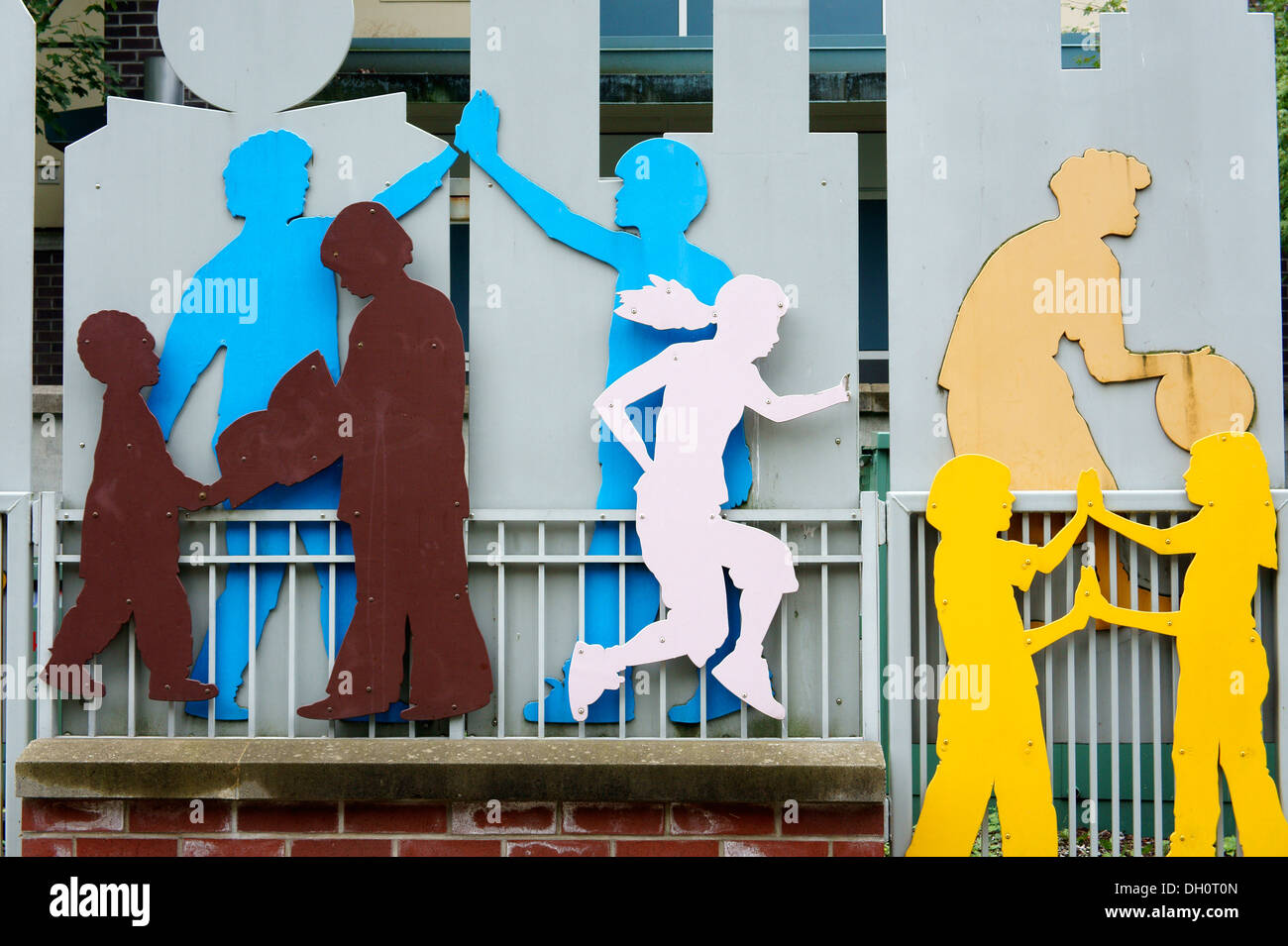 Metal sculpture showing children playing outside Elsie Roy Elementary School, Yaletown, Vancouver, British Columbia, Canada - Stock Image