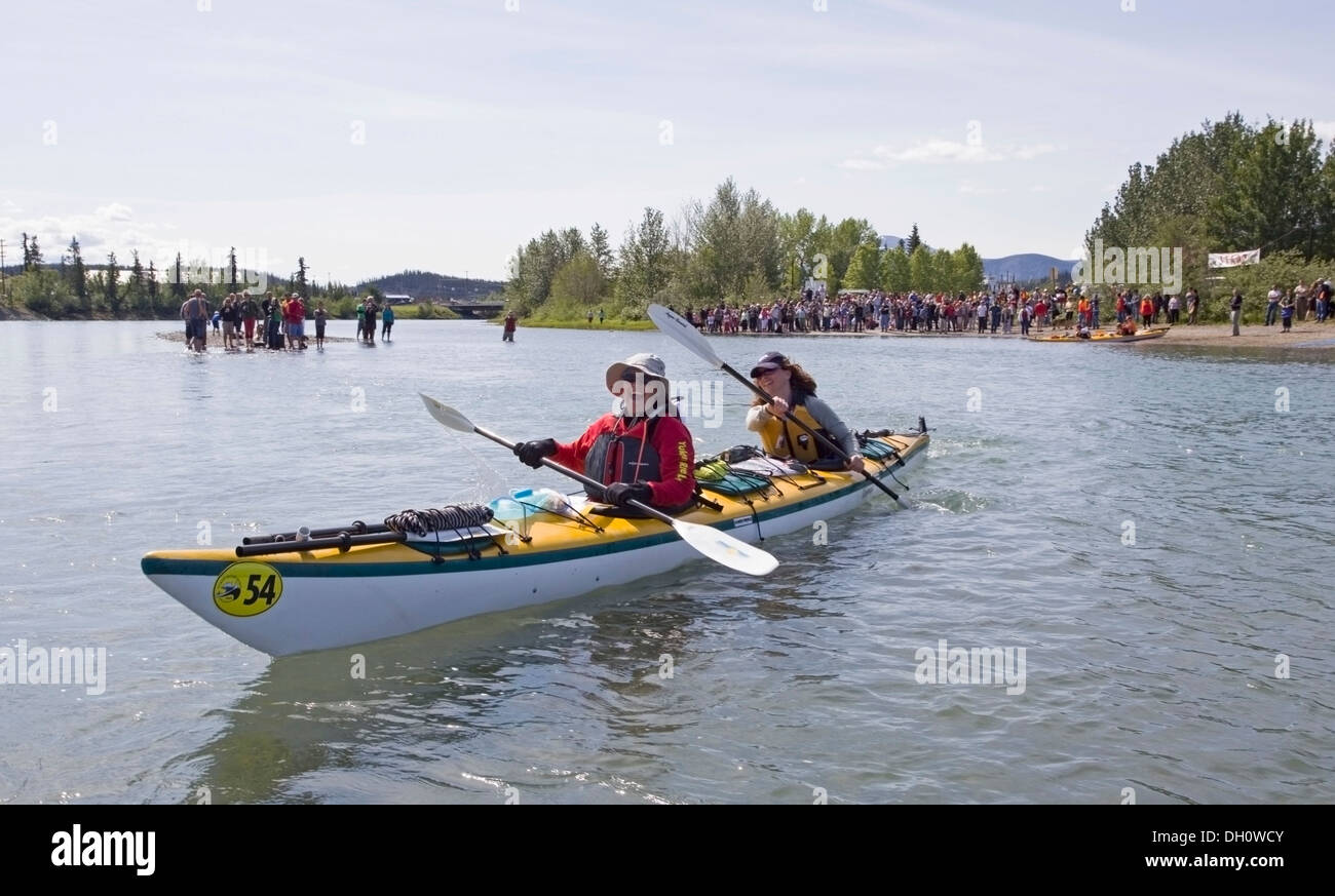Women paddling a double sea kayak, start of the 2009 Yukon