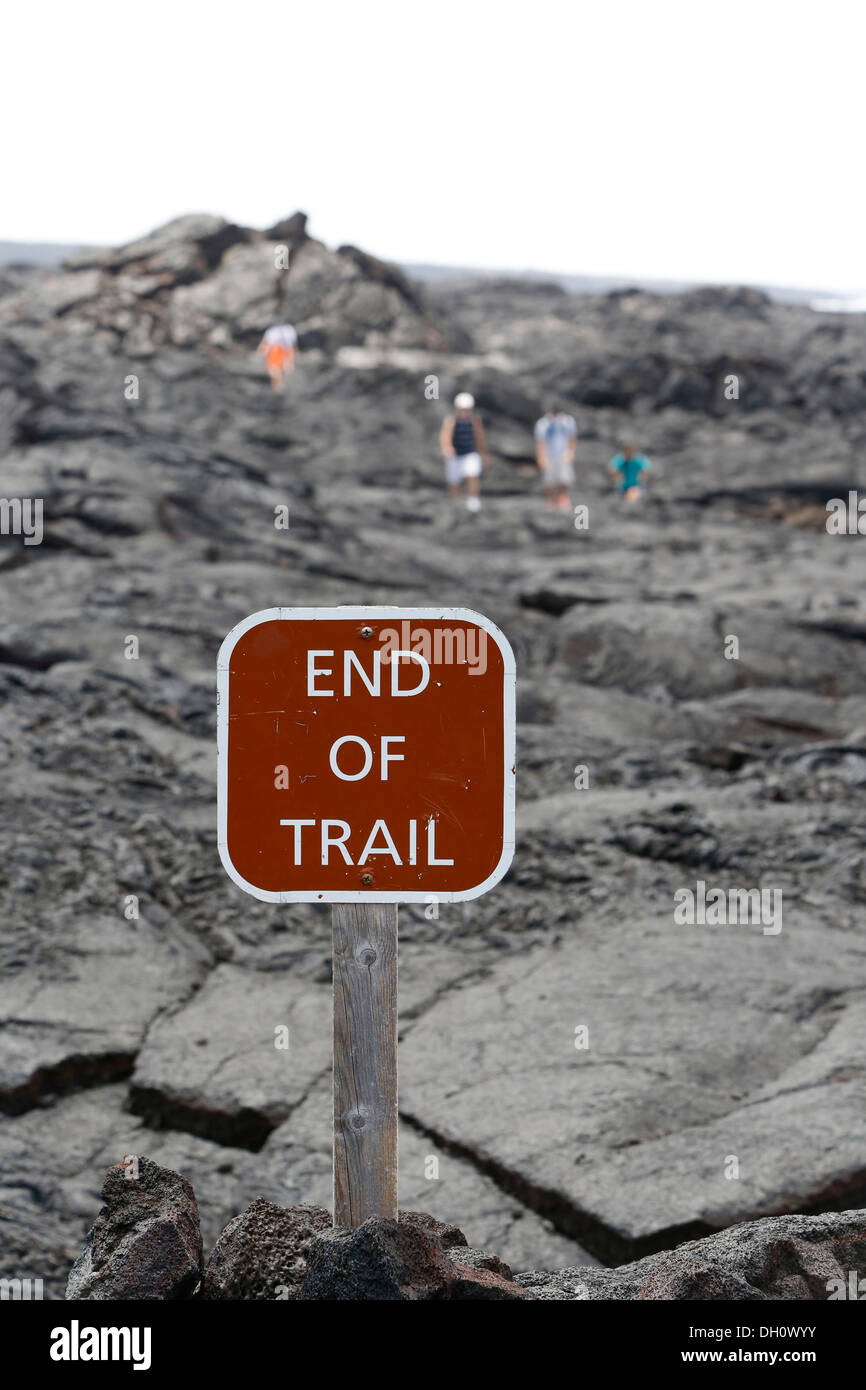 Sign 'End of Trail', hikers at the end of the trail, lava field, East Rift Zone, Kilauea volcano, Big Island, Hawaii, USA - Stock Image