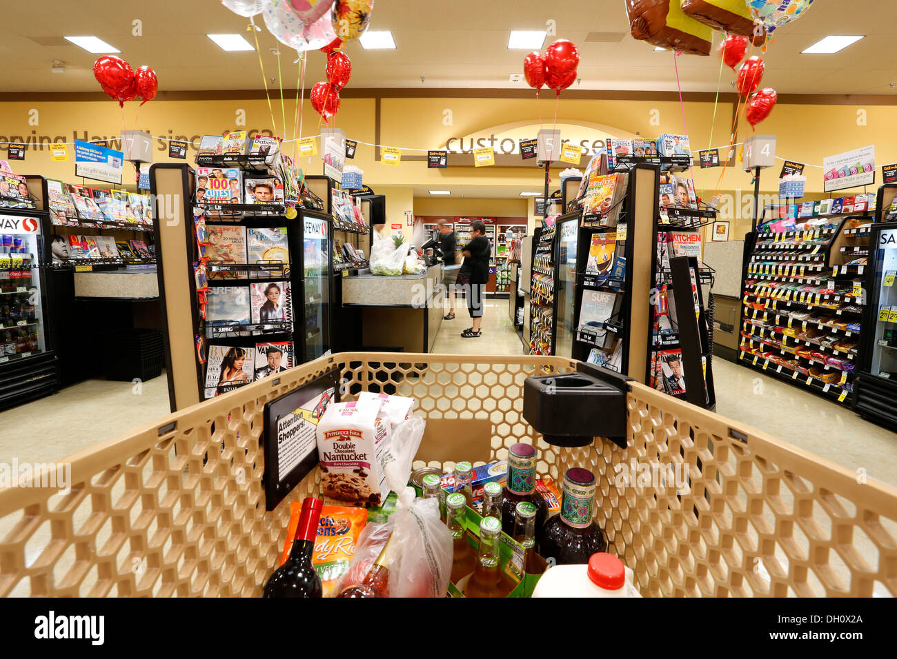 On the way to the checkout, shopping at the supermarket, USA - Stock Image
