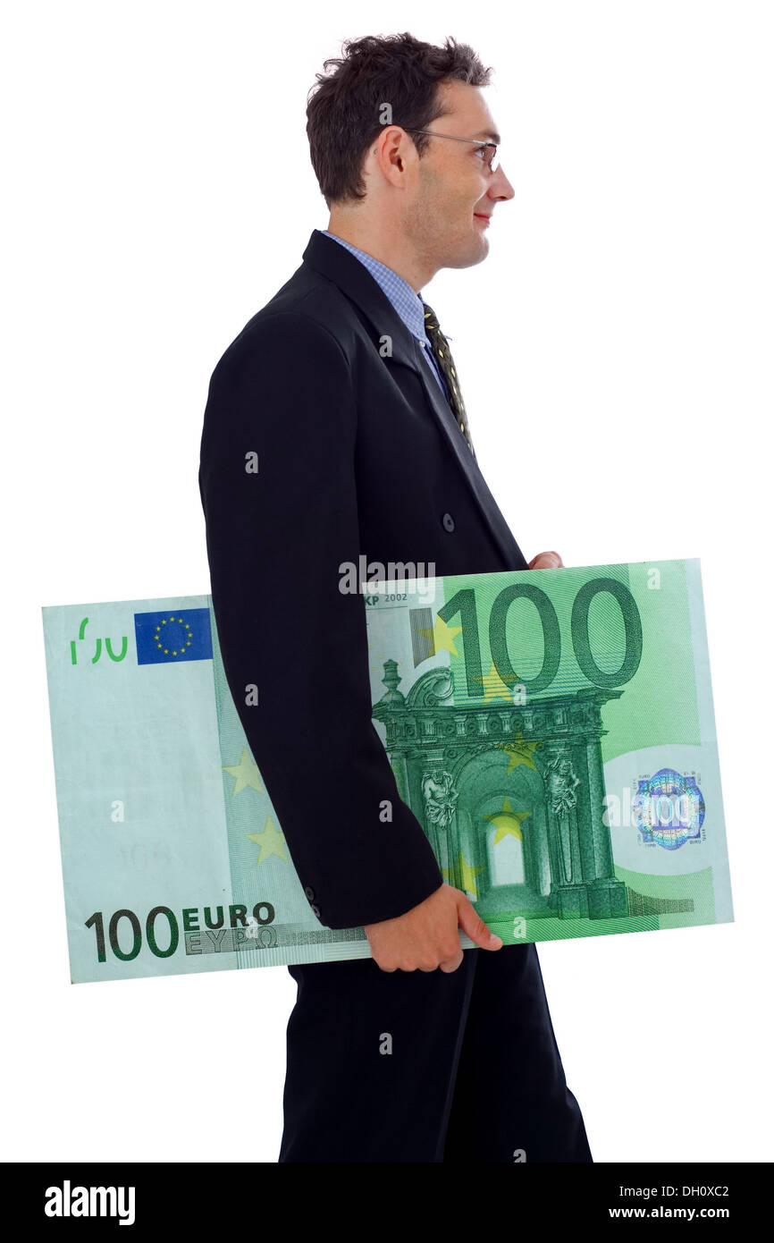 Happy businessman walking with a big hundred euro - Stock Image
