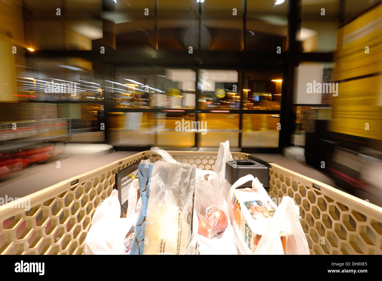 On the way to the exit with shopping bags, shopping at the supermarket, USA - Stock Image